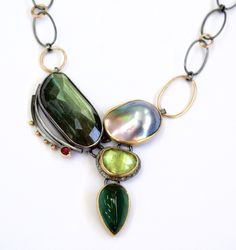 From the Beach Pebble necklace series.  Labradorite, Sea of Cortez pearl, peridot, tourmaline. http://sydneylynch.com