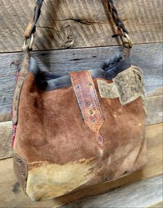 Back: My own J. Augur carpet bag with vintage chaps leather back.