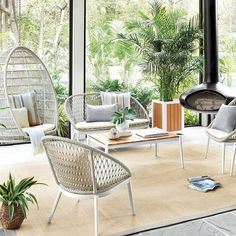 New & Noteworthy Spring Decor Releases - Thou Swell - Katie, you could do the standing chair instead of a hanging chair. Midcentury modern sunroom with o - Indoor Window Boxes, Standing Chair, Sunroom Decorating, Interior Decorating, Decorating Tips, Interior Design, Hammock Chair, Furniture Collection, Outdoor Furniture Sets