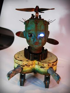 Is it a lamp? Is it art? Is it a toy from Sid's room? Whatever it is...i think we can agree it's CREEPY! {Andy skinner altered doll flying machine}