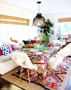 I'M IN LOVE! This is the most perfect dining room ever! I think the colors are perfect together and the mismatch of pieces is the key to a good boho/bohemian look!