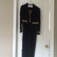 Jumpsuit with matching jacket size 12. Black/gold John Roberts jumpsuit with matching jacket and belt. Zips up back. size 12 . Jumpsuit is black with a gold glittery top. Matching jacket has line of glittery gold to match jacket. Very attractive on. Worn once. Very good condition. Asking price or best offer. Comes from smoke free home John roberts Dresses Long Sleeve