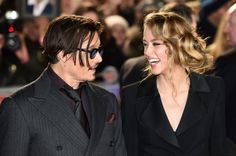 BRITAIN-ENTERTAINMENT-CINEMA-MORTDECAI US actor Johnny Depp (L) jokes with fiancee US actress and model Amber Heard (R) as they arrive for the UK premiere of the film 'Mortdecai' in London on January 19, 2015. AFP PHOTO / LEON NEAL (Photo credit should read LEON NEAL/AFP/Getty Images)