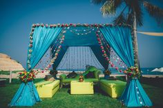 A blue and green color coordinated theme backdropped against the sunny beach and coconut trees of Oman.