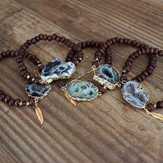 LAST ONE! Beaded Druzy Bracelet Espresso wood round beaded stretch bracelet with gold plated nugget beads. Swarovski crystals, and a statement druzy pendant. Features Function & Fringe's signature gold feather charm. Each druzy pendant has its own unique color and shape, so item may not be exactly the same as pictured. I love wearing them stacked for a fun boho look! Function & Fringe Jewelry Bracelets