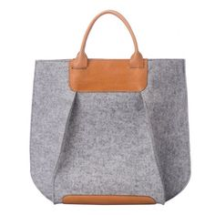 Gräf & Lantz - The look: As if, late one night on set, costumers from Mad Men bonded over their anachronistic love of color-blocking. Based in: Los Angeles Best bet: Gräf & Lantz Frankie gray tote, $395; graf-lantz.com