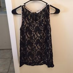 Black lace tank top with tan lining Only worn a few times. In perfect condition. Small zipper in back. Very comfy! Amber Blue Tops Tank Tops