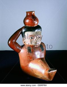 Chavin polychrome ceramic jug in the form of a seated figure carrying a pot, Peru, c900 BC. Artist: Werner Forman - Stock Image