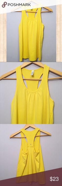 Soybu yellow racerback workout tank Adorable yellow racerback workout tank.  From the brand SOYBU.  General signs of wear. All prices are negotiable so 💕Make offers💕 🚫No trades🚫 Soybu Tops Tank Tops