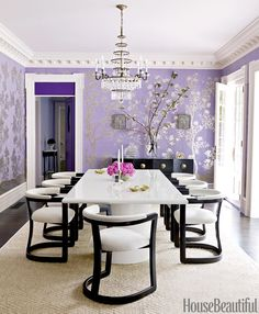 For the dining room of this Massachusetts house, Mary McGee designed a bold lacquered table and contemporary chairs that contrast with the delicate hand-painted Chinese wallpaper by Gracie. Door and transom upholstered in an Edelman leather. Room trim in Benjamin Moore's Ivory White.   - HouseBeautiful.com