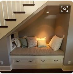 Cute reading nook under the stairs