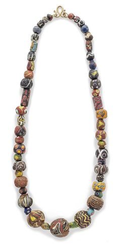 AN ANCIENT POLYCHROME MOSAIC GLASS BEAD NECKLACE