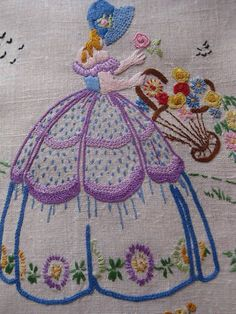 A typical crinoline lady embroidery. …