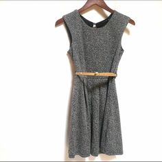Belted Fit and Flare Dress Cute, staple black and white Marled knit dress. Fabric belt loops at side. Back button and side zip. Machine wash. Lined. Belt not included. Excellent condition. Ruby Rox Dresses Mini