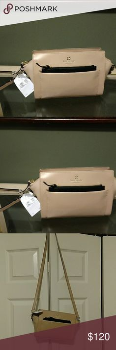 AUTHENTIC KATE SPADE PURSE Authentic Kate Spade Purse. A beautiful nude color purse with a strap. Could be shoulder bag or crossbody. The kate spade and symbol and all the hardware is gold. The purse has an unique feature. It looks like a small zippered wallet is sticking out of the pocket on front of the purse. Very pretty. Smoke and Animal free home.  NWT kate spade Bags Shoulder Bags