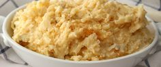 """Learn how to make this popular potluck side—also known as """"funeral potatoes""""—in your slow cooker!"""