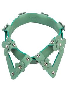 Green leather collar from Yuzefi featuring cut out detail, contrast green edges, leather flower details and silver effect studs.