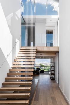 Modern Melkbos Home - Visi Timber Staircase, Staircase Design, Spiral Staircases, Foyer Design, Design Hotel, House Design, Restaurant Design, Foyers, Floating Stairs