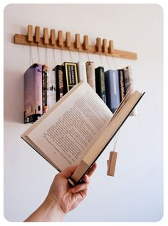 This is a listing for one custom made hanging book rack in Oak wood. The rack comes with a set of 12 pins/bookmarks. The pins are detached and can be
