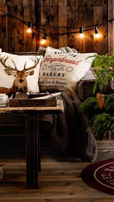 33 Cute Log Cabin Christmas Decorations Reindeer inspired pillows with rustic Christmas decor… I love the lights against the wood wall!