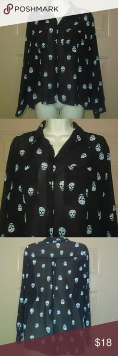 """""""COTTON ON"""" SKULL BLOUSE-SIZE S-SUPER CUTE -Cotton On Skull Blouse -Size Small -Super Cute!!!! -Perfect Condition, Gently Worn -Long Sleeves but can be rolled up to a tab and button -Two buttoned pockets in front -Black sheer material with white skulls -Buttons fasten down the front -Armpit to armpit measures 21"""", straight across -100% Polyester -Made in Australia Cotton On Tops Blouses"""