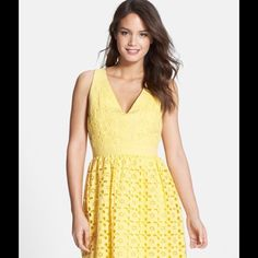 """Eyelet V-Neck Fit & Flare Dress Cheery yellow cotton punctuated with floral eyelets defines the sunny appeal of this charming V-neck dress. - 36"""" length - Exposed back-zip closure - Fully lined - 100% cotton Laundry by Shelli Segal Dresses Mini"""