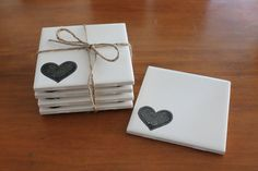 Set of 4 tile coasters. White with black heart stamp. Waterproof seal. by ACuriousWonderland on Etsy
