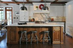 Traditional Kitchen Design Ideas, Pictures, Remodel and Décor: Like that you still have cabinets on the side but the stools don't stick out