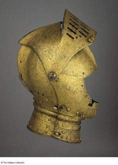 Close-helmet  Attributed to Conrad Richter, Armourer  Augsburg, Germany  1555  Medium-carbon steel, copper alloy, leather, wax, gold, silk and velvet, etched and gilt  Weight: 5.62 kg  Height: 33 cm  Width: 17 cm  A188  European Armoury II Gold Armor, Necron, Knight Armor, Suit Of Armor, Arm Armor, Medieval Armor, Dark Ages, Augsburg Germany, 16th Century