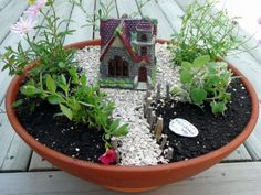 Fairy garden ~ I like that its small and in a pot. Zoe would like this.
