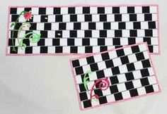 Illusions Tablerunner and Placemat Pattern. What's going on here anyway? Those sloping lines are actually parallel, but don't tell!  Enjoy sewing this easy to make optical illusion. Use black and white for the best contrast and the most bizarre look.,/p>   Instructions are included for the runner and placemats. Finish the look with raw edge applique and quick quilting. http://www.kayewood.com/item/Illusions_Placemat_and_Tablerunner_Pattern/2282 $9.99