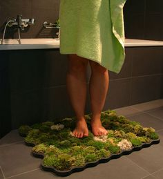 How to make a live moss bath mat. Moss Bathmat: To create it, get yourself a length of thick polyethylene foam from the hardware store, carve out cups for your mosses to be tucked into, and then place it outside your bathtub or shower enclosure to soak up drips when you step onto it.