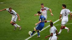 Four players swarm as Messi runs.