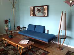 Mid Century Modern living room set. Love the colors of the wood here and the creative design.