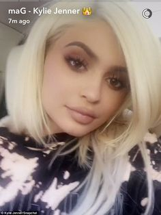 Kylie Jenner shows off her TINY waist as she poses for photos in thick gold belt and camouflage T-shirt | Daily Mail Online