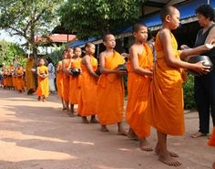 Giving alms to monks in the village of Ban Pho NE Thailand.  Visit our art and photography guest house in NE Thailand http://thailand-painting-holidays.com #painting #holiday #thailand #travel #vacation #photography #culture #experience http://www.jeremyholton.com by Jeremy Holton https://plus.google.com/u/0/104359568476968412848?rel=author