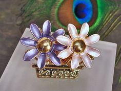 Was $15 - now only $10!  Purple Flowers HUGE Fashion Costume Cocktail Ring - Up-cycled Pin - Adjustable Size  HUGE fashion rings - costume rings - are FUN to wear! Thats why they are so popular right now! Get in on the trend with this up-cycled Pin Ring. For this ring I took a vintage pin (over 20 years old LOL!) that had a broken clasp. I filed down the broken clasp bits until they were smooth and attached it to an adjustable ring base with extra strong jewelers epoxy. NOTE: I moved these…