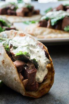An easy and delicious tri tip taco recipe! Topped with a delicious cilantro lime sauce- you can't go wrong with these tri tip tacos! An easy and delicious tri tip taco recipe! Topped with a delicious cilantro lime sauce- you can't go wrong! Tri Tip Steak Recipes, Beef Recipes, Cooking Recipes, Recipies, Cheap Recipes, Spinach Recipes, Cooking Tips, Quesadillas, Tostadas