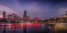 Brisbane Riverwalk - Pinned by Mak Khalaf And tonight the bridge is .....red! Brisbane City viewed from Riverwalk New Farm. City and Architecture sunsetarchitectureaustraliabrisbanebrisbane rivercitycomposited600dusklelight trailsmark lawsonnightqueenslandreflections by Mark_Lawson
