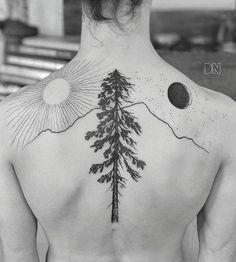 Pine tree, sun and moon tattoo.