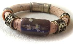 Cafe Latte by Finales on Etsy Kazuri focal with antique gold accents make this bracelet a winner! All on a natural cork band and attached with a matching magnetic clasp. Casual or dressy... YOU decide!  $40.00  https://www.etsy.com/listing/222391869/cafe-latte?ref=shop_home_active_2