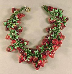 Bakelite and Celluloid Strawberry Necklace ~  Loosely strung with bunches of fruit. Length 14 inches.
