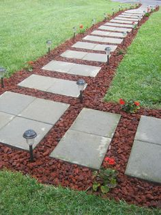 I'm thinking of something like this - but less of a perfectly straight line & with white rocks & then lots of random colored glass marble/gem/rocks {like you put in a vase}.  I got 11 of the pavers up today {oy vey does my back ache, but slipping & falling would hurt a lot more, don't want to do that, again} so we shouldn't have a mud slip & slide for much longer out front. ~Ariel
