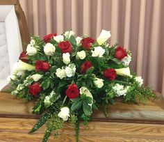 Casket spray of red and white roses along with calla lilies. Different greens for more texture. Red Rose Arrangements, Funeral Flower Arrangements, Funeral Flowers, Red And White Roses, Red Roses, Funeral Sprays, Casket Sprays, Sympathy Flowers, Christmas Tablescapes