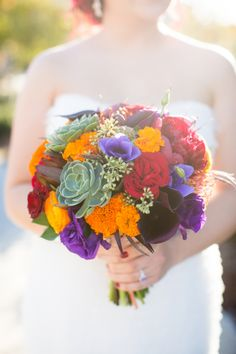 Loving this succulent bouquet with reds, purples, and golds.... perfect for a fall wedding!