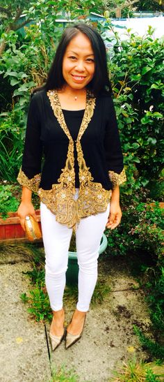 Indonesian's kebaya teamed up with white jeans for less formal look