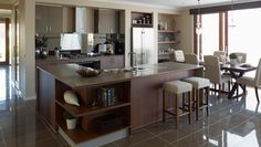 Like the colour of the kitchen cabinets. And the cool shelf system in the background