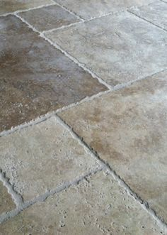 Versailles pattern chiseled travertine floors.