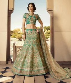 Buy Turquoise Green N Beige Embroidered Lehenga Choli online from the wide collection of Lehenga. This Green, Beige colored Lehenga in Net, Art Silk fabric goes well with any occasion. Shop online Designer Lehenga from cbazaar at the lowest price. Lehenga Choli Online, Ghagra Choli, Silk Lehenga, Indian Bridal Lehenga, Indian Bridal Fashion, Pakistani Bridal, Choli Designs, Lehenga Designs, Lehenga Online Shopping