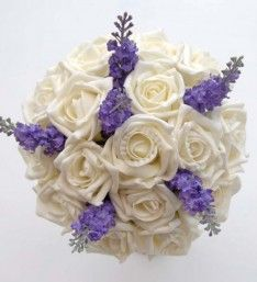 A lovely bridesmaids wedding bouquet handmade in a round design with an easy to carry handle. Featuring ivory roses and lilac/purple silk lavender. Lavender Bridesmaid, Bridesmaid Bouquet, Wedding Bridesmaids, Wedding Bouquets, Foam Roses, Lilac, Purple, Ribbon, Ivory
